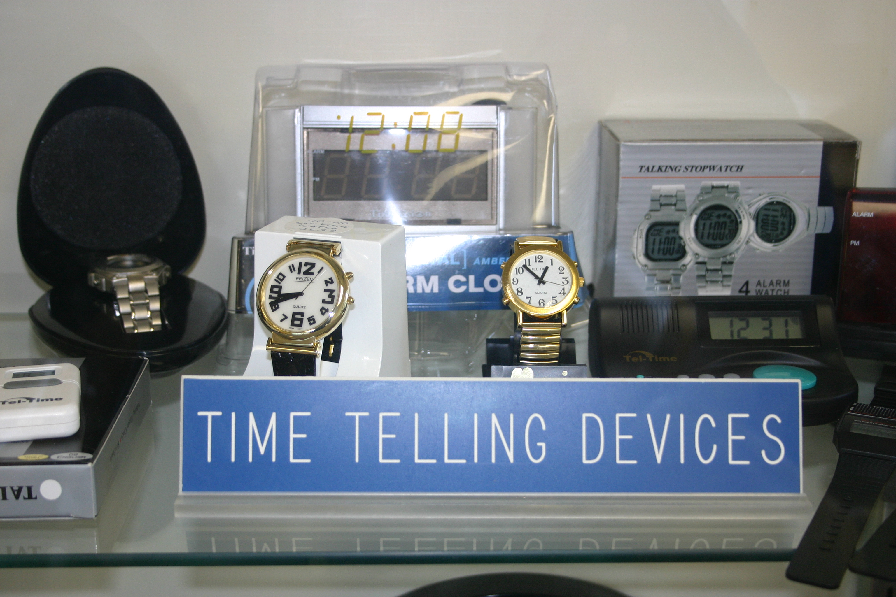 Picture of accessible time telling devices including talking and large print watches and clocks.