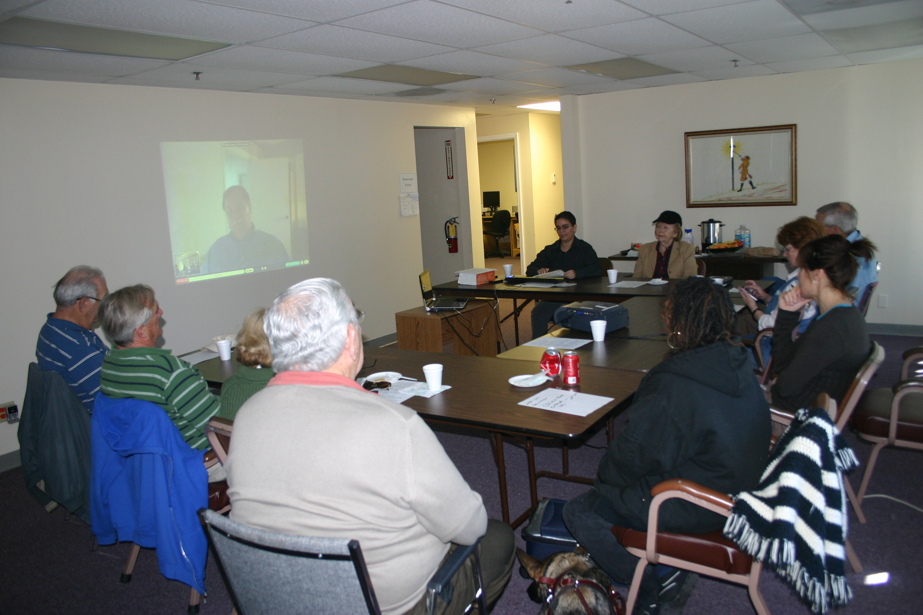 Boot Up Club members at a meeting listening to a speaker present virtually through Skype.