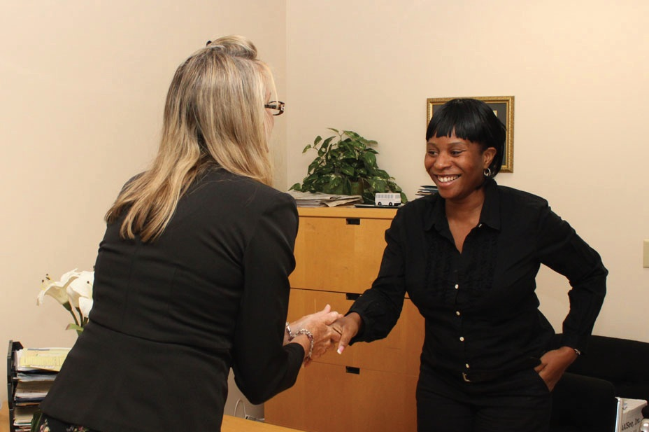 Mary Allen, Director of Vision Services, shaking hands with Tekesha Saffold.