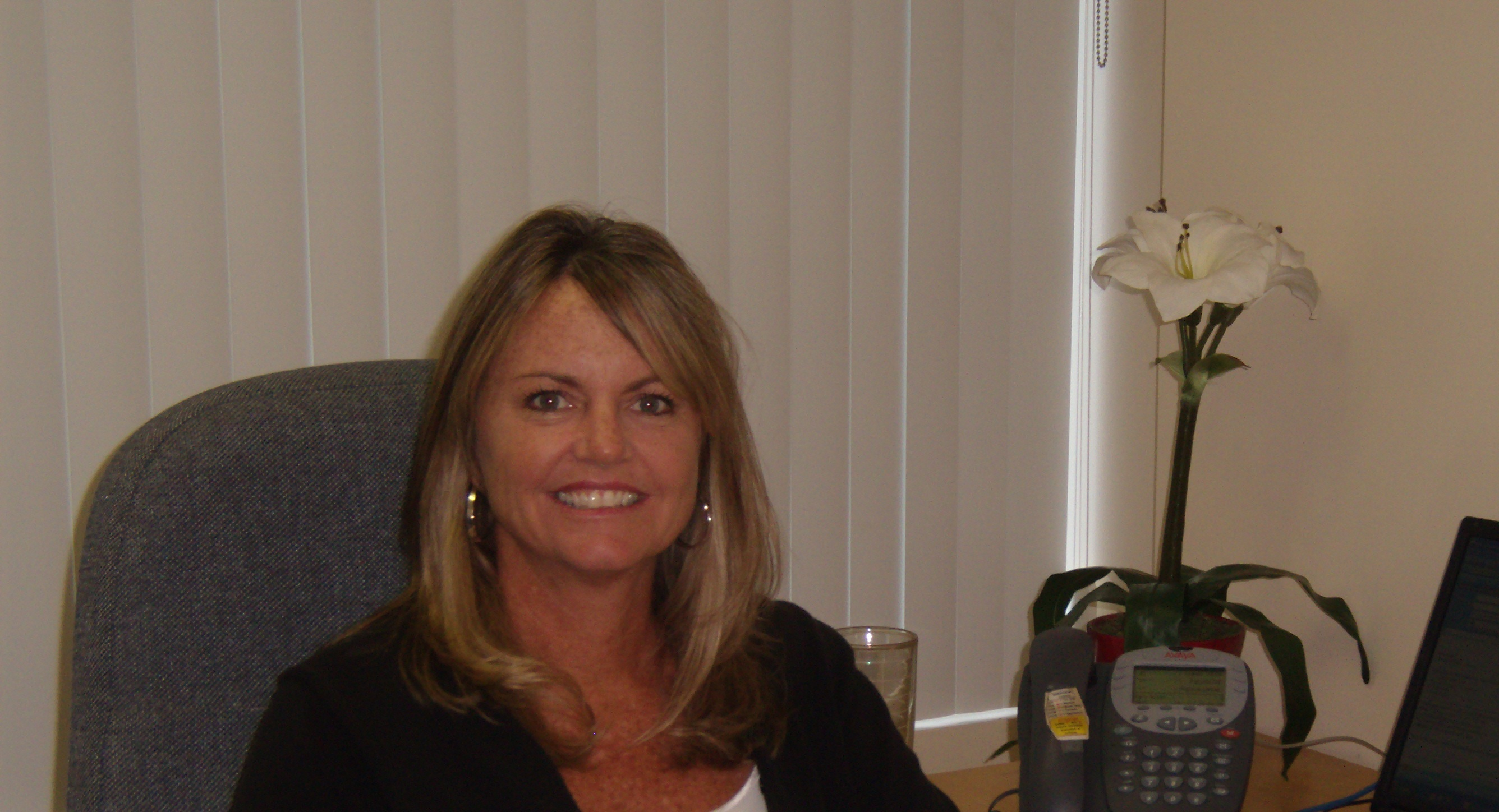 Mary Allen, Director of Vision Services at her Desk