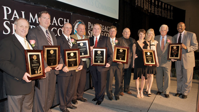 The 2009 Induction Class from left to right; Jack Rhine, Charlie Persson, Tom D'Angelo, Mark Calcavecchia, Bill Davis, Joey Ceravolo, Don Thompson (on behalf of Web Pell), Kelly Piggot and Nicole Preston accepting for their late father Darryl Ceravolo, Howard Schnellenberger and Derek Harper